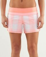 Lululemon groovy run shorts size 4 in gros gingham bleached coral pop orange