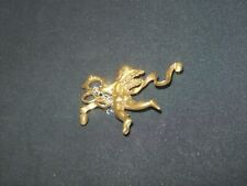 GOLD TONE ANGEL WITH GARLAND BROOCH