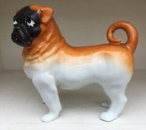 ANTIQUE GERMAN PORCELAIN MODEL OF A STANDING PUG DOG