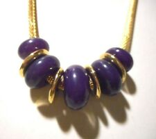 Liz Claiborne necklace with purple/blue cabichon beads & gold tone spacer beads