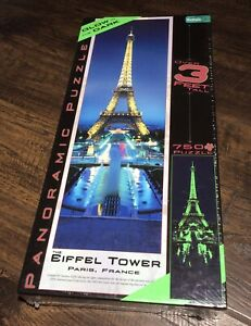 Buffalo Games:The Eiffel Tower Glow In the Dark Panoramic 750 Piece Puzzle (New)