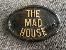 The Mad House Door plaque