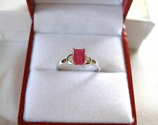 Celine F.-  .70 Ct. Ruby Solitaire & Diamond  10k White Gold Ring