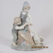 Lladro figurine Avoiding the Goose boy girl snapping goose flowers pastel colors