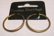 Lovely gold tone metal hoop style earrings approx 1 ins diameter