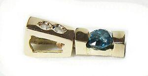 Dije de oro 18 cts con diamantes naturales (azul y blancos)