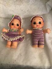 Pair of vinyl 4 inch Cupie Dolls in handmade crochet outfits
