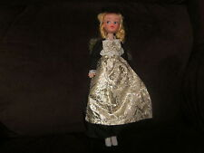 Vintage cheap plastic look alike pouty Sindy doll in fun costume