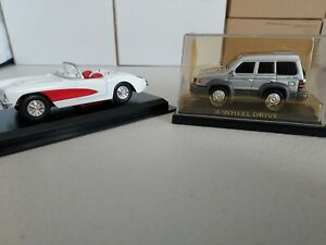 2 Scale Model Vehicles - unbranded 1:43 roadster and smaller scale Pajero