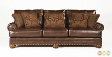Ashley Antique Brown Bonded Leather Sofa Rolled Arms Nailhead Trim With Pillows