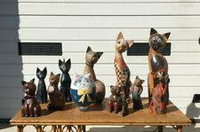 11 chats en bois