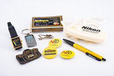 Collection of Nikon Camera Advertising Playing Cards Soap Pins Watch Pen V11