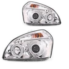 Set fanali Hyundai Tucson anno 05-10 vetro chiaro/cromo Angel Eyes h1+h1 l3f