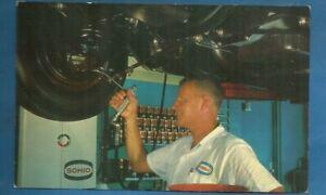 Akron, Oh/ Carl's Sohio Service/ man working on tire/ chrome advertising postcrd