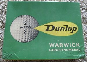 DOZEN BOX WITH WRAPPED GOLF BALLS (10) DUNLOP WARWICK LARGER NUMERAL MADE IN UK