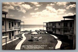RPPC postcard Anchorage Beach Colony Daytona Beach FLA hotel courtyard 1138