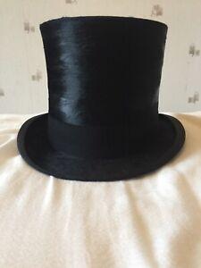 Antique/Vintage silk top hat. 58cm around inner brim 16cm tall price negotiable