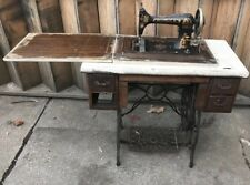MINNESOTA  A TREADLE SEWING MACHINE IN CABINET WITH CHAIN LIFT TOP