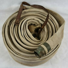 More details for vintage canvas fire hose with brass end fittings & leather strap. fireman.