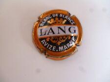 capsule LANG sans encoche, très bon état , grandes lettres, très rare