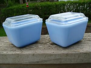 pair of light blue Pyrex refrigerator dishes