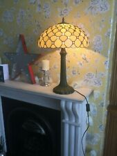 Tiffany style table lamp and matching ceiling light.