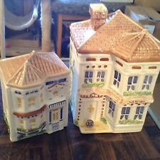 Pair of Avon townhouse canister collection houses B & C