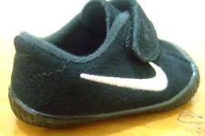 Chaussures blanches Nike pour bébé