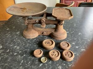 vintage cast iron weighing scales with weights