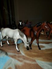 Hartland dapple grey grazing mare and glossy bay stallion vintage