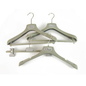 Set of 4 Christian Dior Light Gray Plastic Hangers with printed Logo