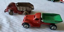 2 ANTIQUE RED HUBLEY CAST IRON DUMP TRUCKS #2308 MADE USA.ONE GREEN /ONE SILVER