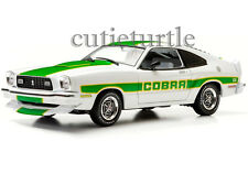 Greenlight 12895 1978 Ford Mustang Cobra II 1:18 Free Wheelin White with Green
