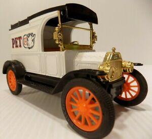 Ertl 1913 Ford Model T Pet Milk Truck W/Orange wheels issued 1983 Coin Bank NOS