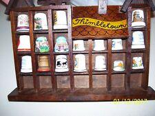LOT OF 22 ASSORTED THIMBLES & WOODEN HOUSE THIMBLE HOLDER & BOOK, AVERIL MATHIS