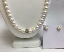 10.5mm Cultured Freshwater Pearls. 18k Gold And Diam Center