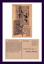 ILLINOIS AURORA COAT POCKET REXO CAMERA ADVERTISING POSTCARD CIRCA 1920