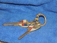 Two Original vintage 1950s Lincoln automobile brass key auto promo accesories