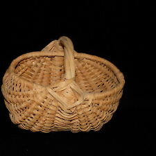 "BUTTOCKS BASKET SMALL CANE HANDWOVEN EYE OF THE GOD 7 1/2"" L X 6"" W X 4"" D"