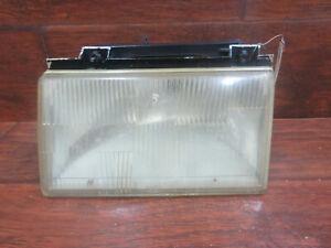 Ford Tempo, Mercury Topaz:  1988, 1989, 1990 -1994, Left Headlight W/Bracket