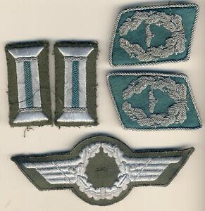 frühe Effekten KVP DDR Flieger Uniform Schirmmütze,Kragenspiegel Ärmelpatten NVA