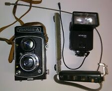 Vintage Yashica-A copal camera with Trigger Grip and Flash
