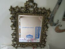 antique heavy gold guilded metal frame with beveled mirror