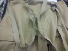 Tan military trousers with braces