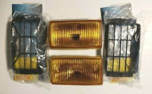 BOSCH PILOT 150 GRILLS WITH AMBER YELLOW  LAMPS NOS SAAB VOLVO BMW