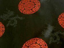 Jacquardstoff schwarz mit roten Glückszeichen Meterware