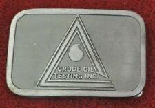 Belt Buckle: Crude Oil Testing Inc.