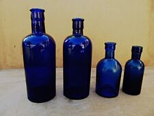 4 VINTAGE GRADUATED BLUE APOTHECARY / CHEMIST / PHARMACY BOTTLES