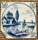 Antique 19C Dutch Delft blue and white tile featuring ships and windmills