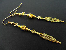 A PAIR OF  GOLD COLOUR  FEATHER THEMED DANGLY   EARRINGS. NEW.